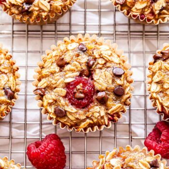 Raspberry Chocolate Chip Baked Oatmeal Cups on a wire cooling rack.