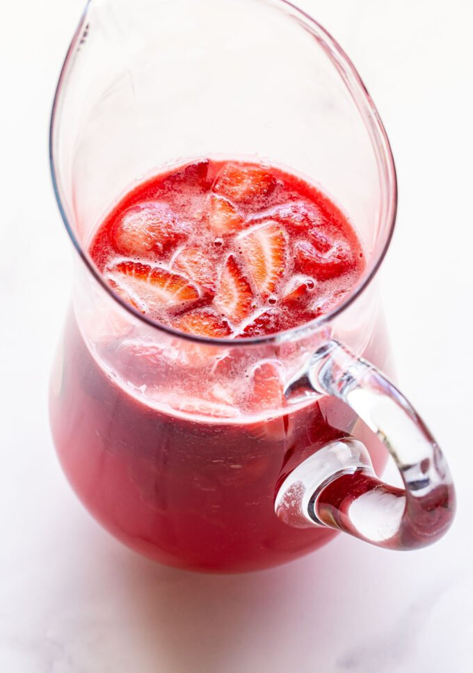 Overhead photo of a glass pitcher filled with Strawberry Watermelon Rosé Sangria