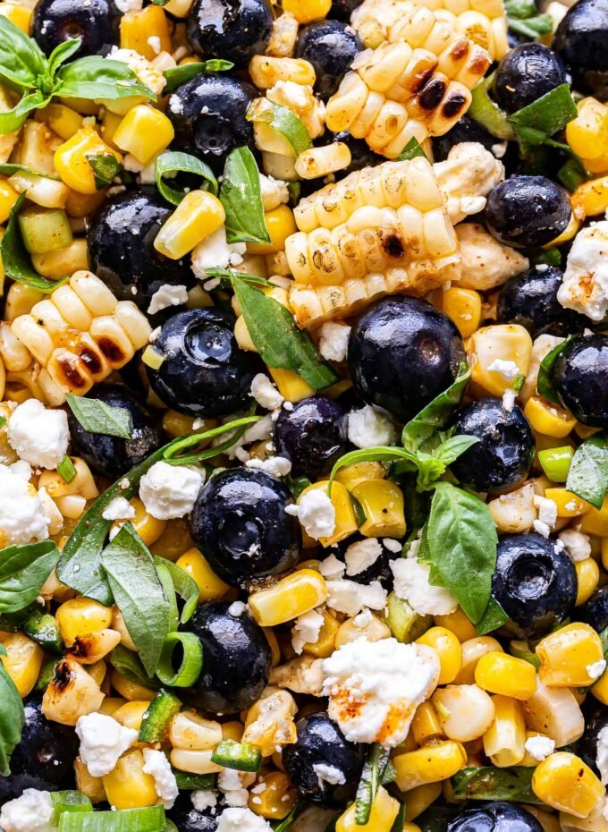 Closeup photo of Blueberry Corn Feta Salad with basil.