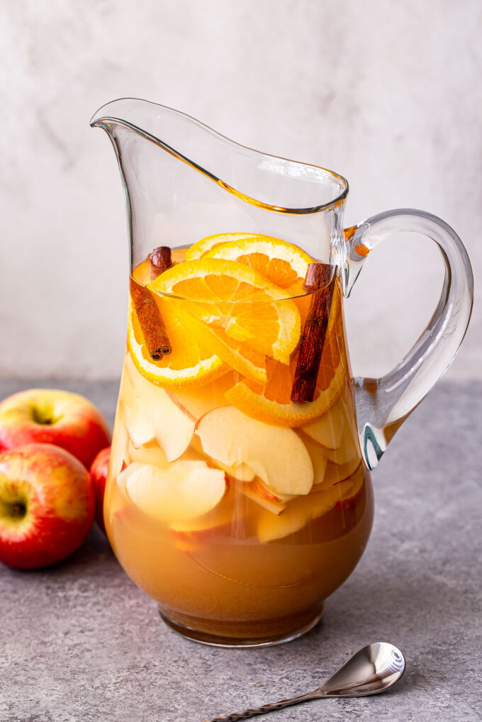 Front view of a pitcher of apple cider sangria.