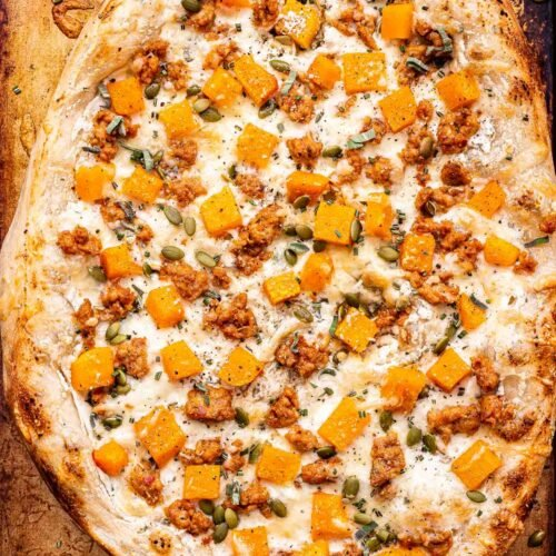 Overhead photo of the whole Butternut Squash Sausage and Ricotta Pizza on a sheet pan.