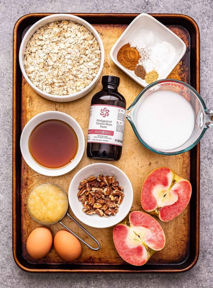 Sheet pan with the ingredients used to make the Apple Cinnamon Baked Oatmeal Cups.