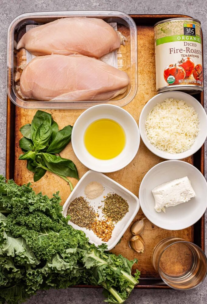 Creamy Italian Chicken Skillet ingredients on a sheet pan.