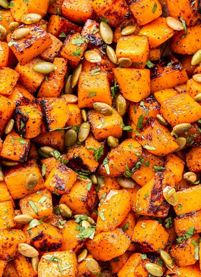 closeup of Sweet and Spicy Roasted Butternut Squash with pepitas and cilantro.