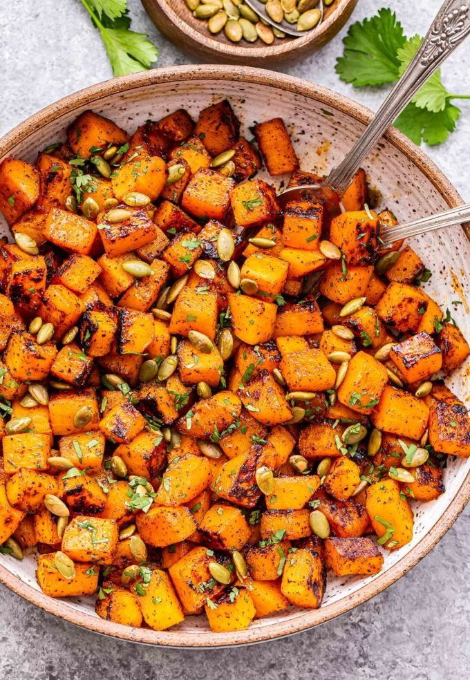 Sweet and Spicy Roasted Butternut Squash in a white serving bowl