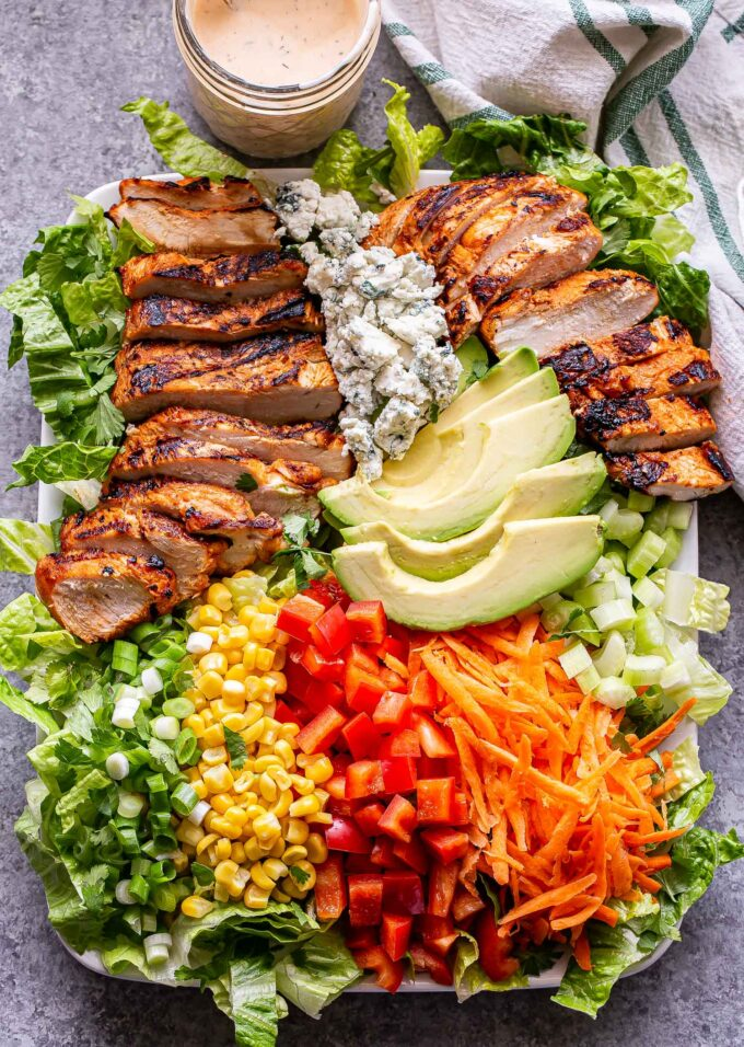 grilled buffalo chicken on top of lettuce with green onions, corn, red peppers, carrots, celery, blue cheese and avocado.