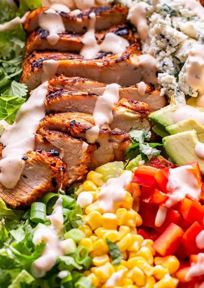 grilled buffalo chicken on top of lettuce with corn, red peppers, blue cheese.