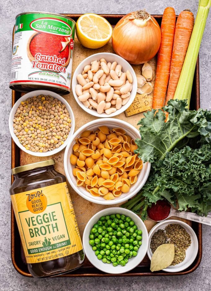 Ingredients used to make Lentil Minestrone Soup on a sheet pan.