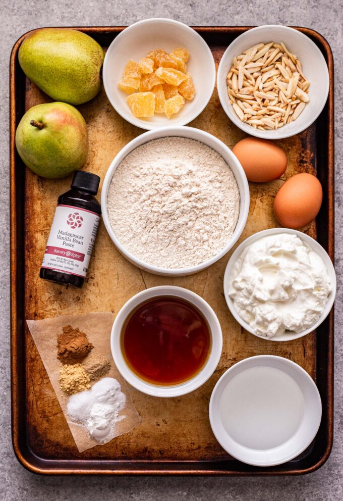 Ingredients used to make Pear Ginger Muffins on a sheet pan.