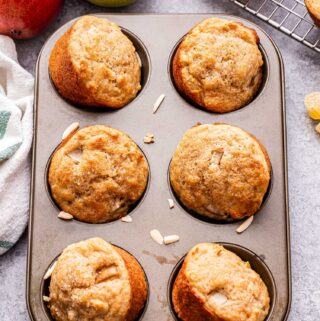 Six Pear Ginger Muffins in a muffin pan.