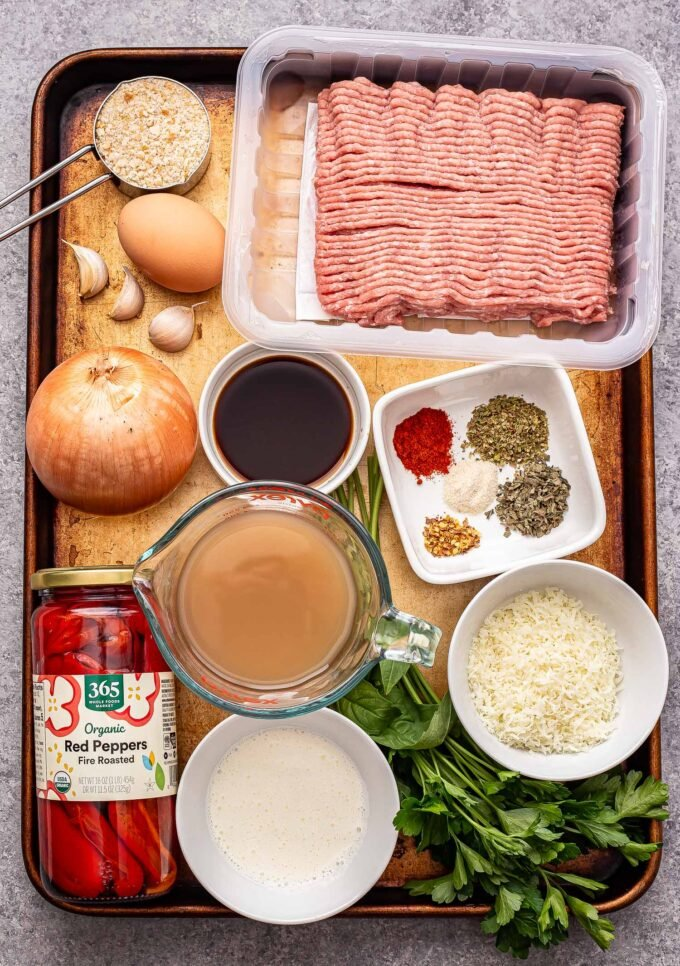 Ingredients used to make Turkey Meatballs in Roasted Red Pepper Sauce on a sheet pan