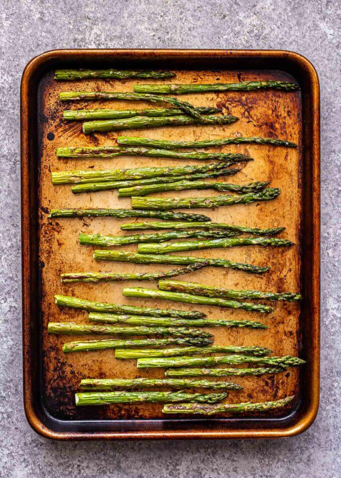 roasted asparagus on a sheet pan.
