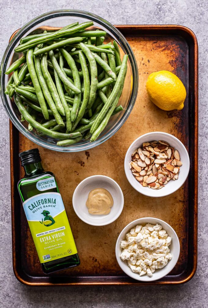 Ingredients used to make Green Bean Salad with Feta on a sheet pan.
