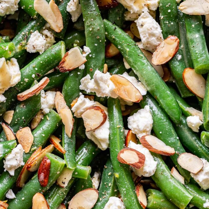 closeup photo of Green Bean Salad with Feta and sliced almonds.