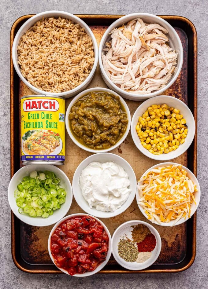 ingredients used to make Green Chile Chicken and Rice Casserole on a sheet pan.