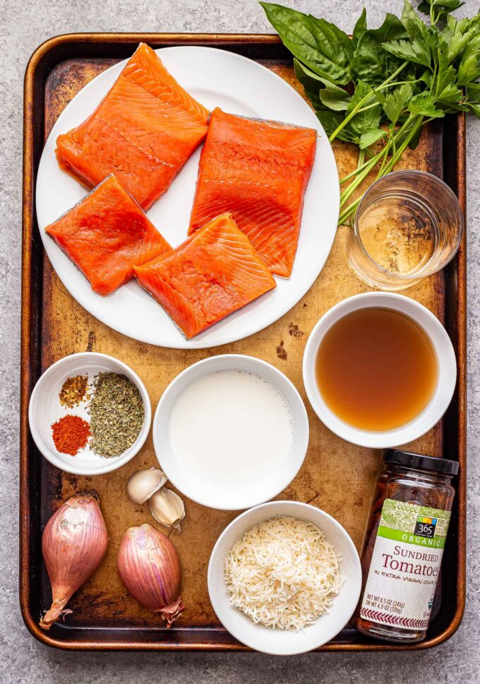 ingredients used to make Creamy Sun Dried Tomato Salmon on a sheet pan.