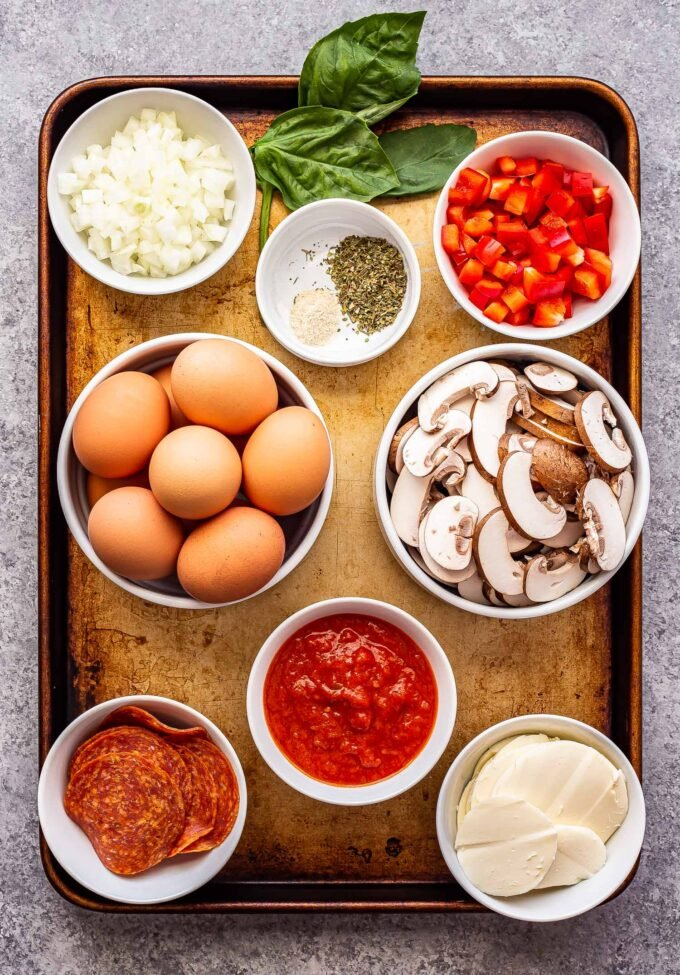 ingredients used to make sheet pan pizza frittata on a sheet pan.