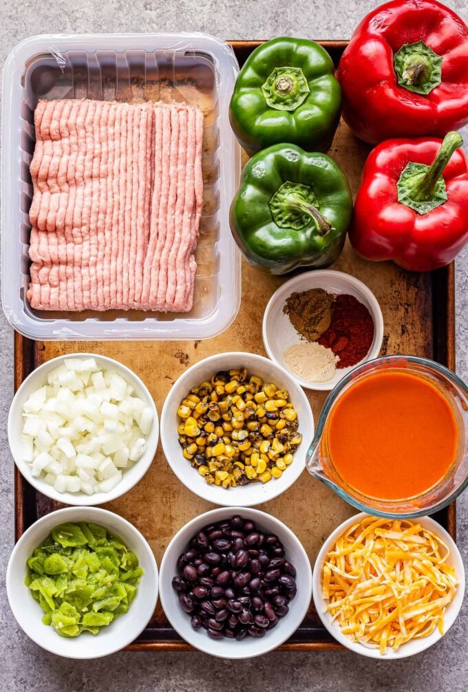 Ingredients used to make taco stuffed peppers on a sheet pan.