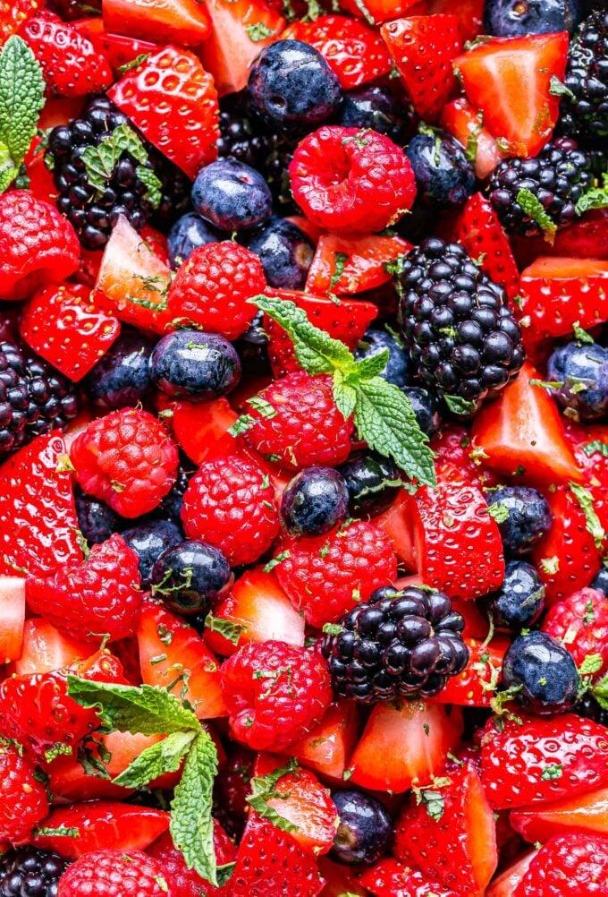 Closeup of Berry Fruit Salad. Made with strawberries, raspberries, blueberries, blackberries and mint.
