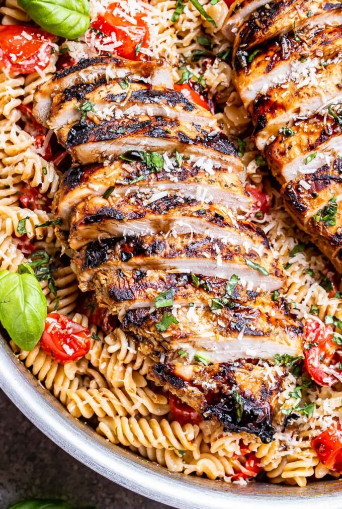 Tomato Basil Pasta with sliced Balsamic Grilled Chicken on top of it