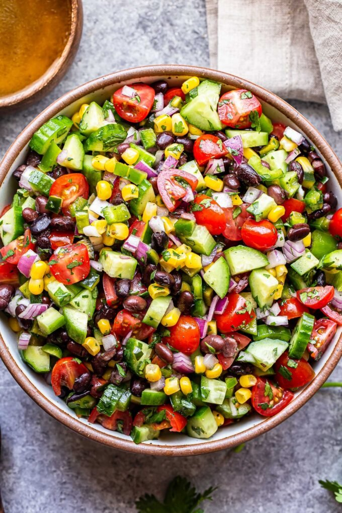 black bean and corn salsa salad in a white serving bowl.