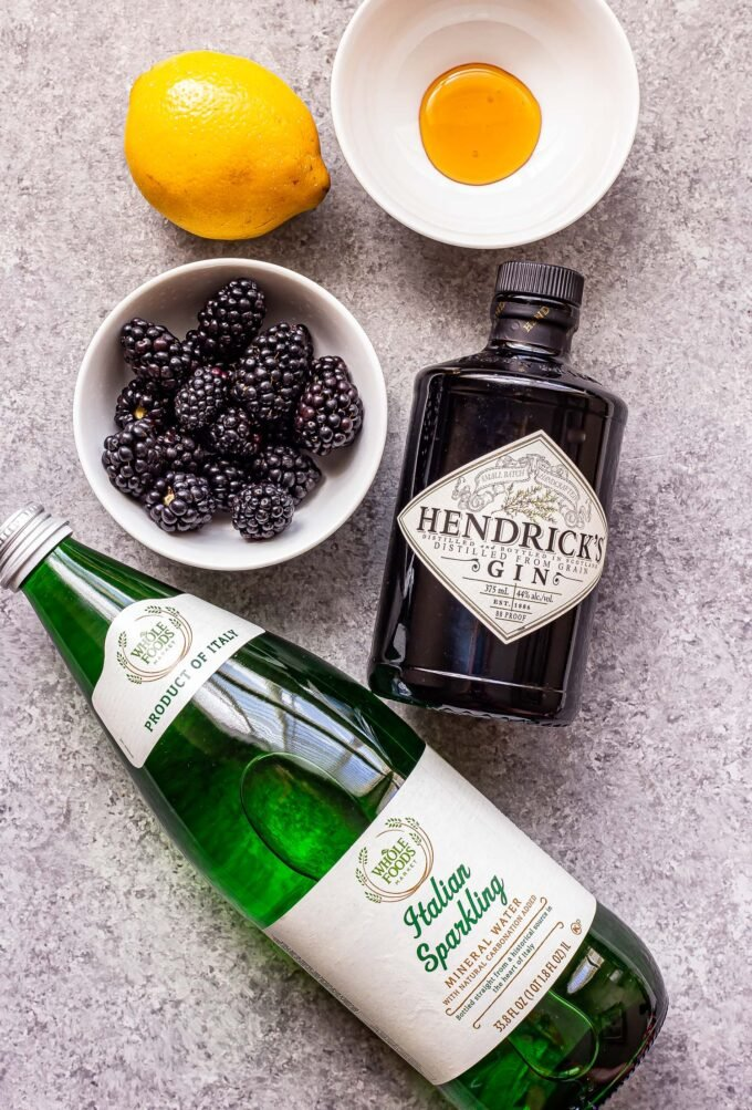 Ingredients used to make blackberry gin fizz cocktail.