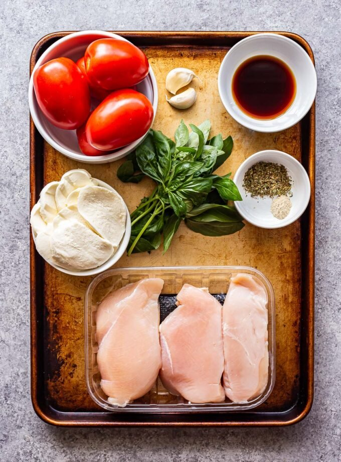 ingredients used to make grilled bruschetta chicken on a sheet pan.