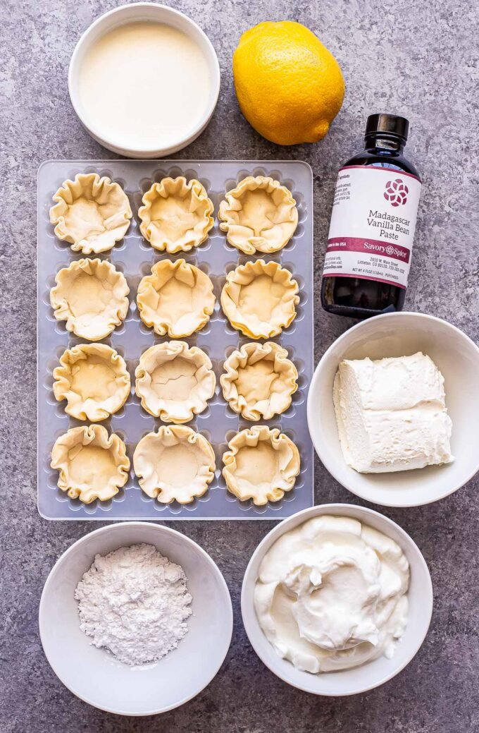 Ingredients used to make Mini Lemon Cream Pies on a gray countertop.