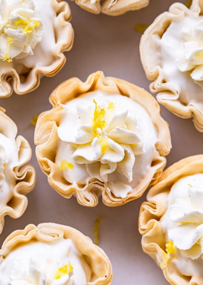 Overhead closeup of a Mini Lemon Cream Pie in a phyllo cup topped with whipped cream.