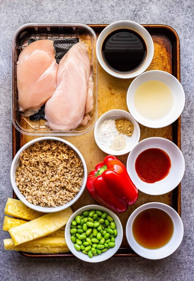 ingredients used to make teriyaki chicken and rice bowls on a sheet pan.