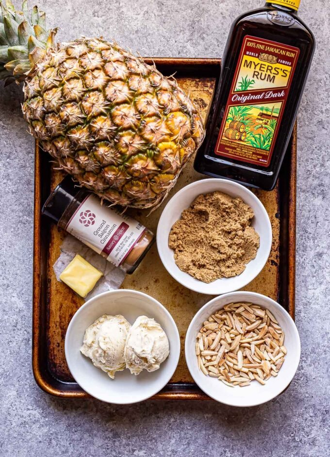 Ingredients used to make Grilled Pineapple with Rum Sauce on a sheet pan.