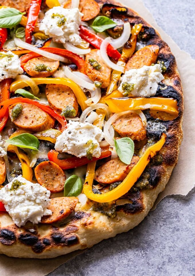 Grilled Sausage and Peppers Pizza topped with dollops of ricotta.