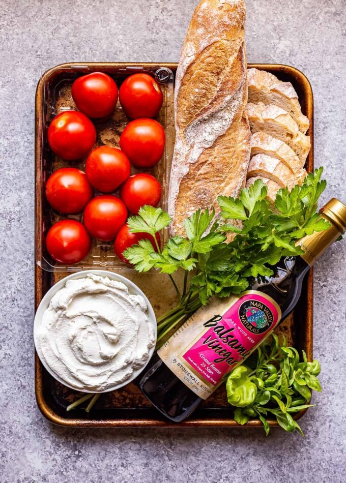 Ingredients used to make Grilled Tomatoes with Ricotta on a sheet pan