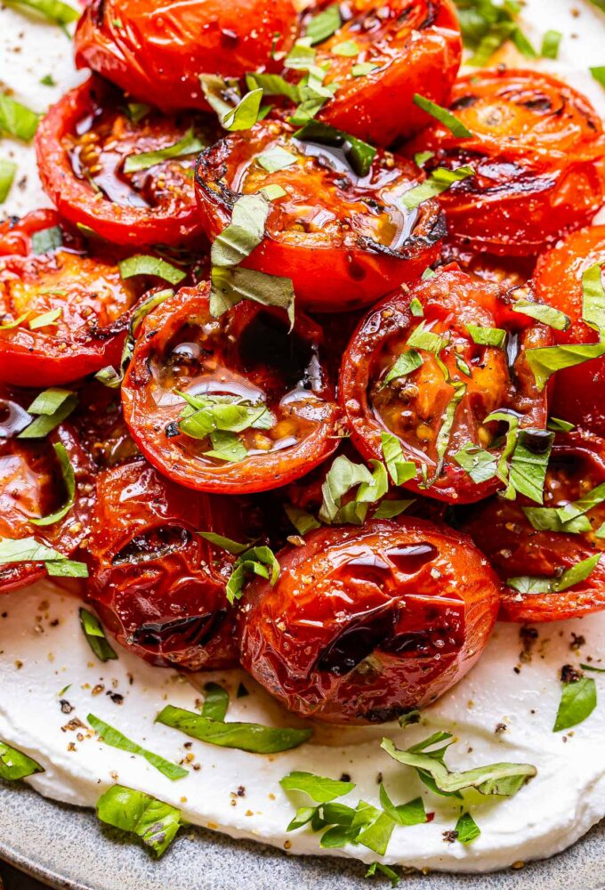 Ricotta topped with halved grilled tomatoes, fresh herbs and balsamic glaze.