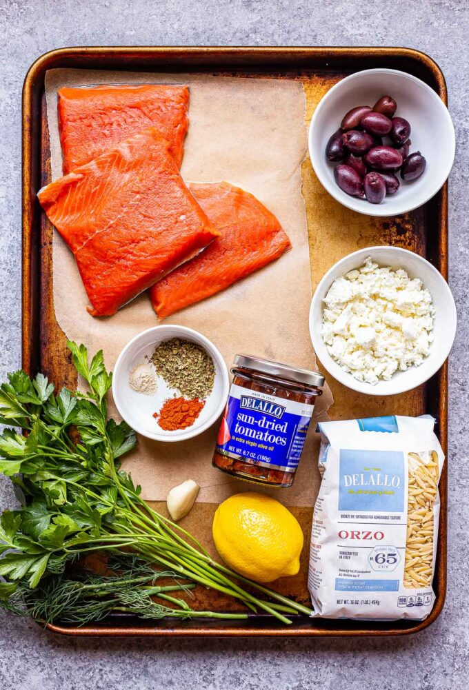 Greek Salmon and Orzo Skillet ingredients on a sheet pan