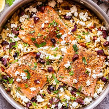 Greek Salmon and Orzo in a stainless steel skillet