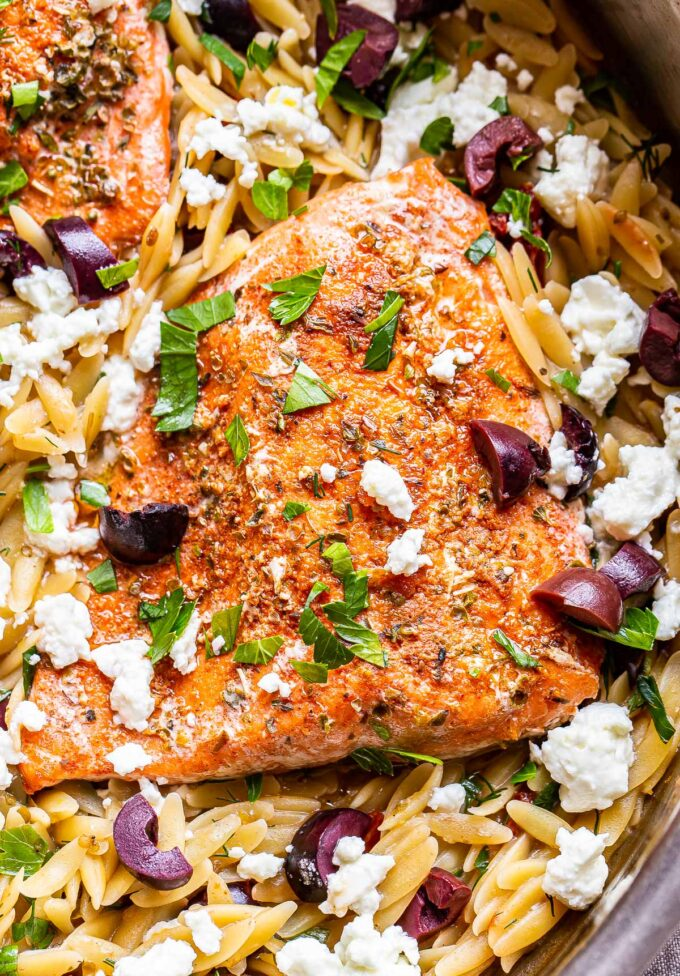 greek spiced salmon fillet on top of orzo with feta and kalamata olives