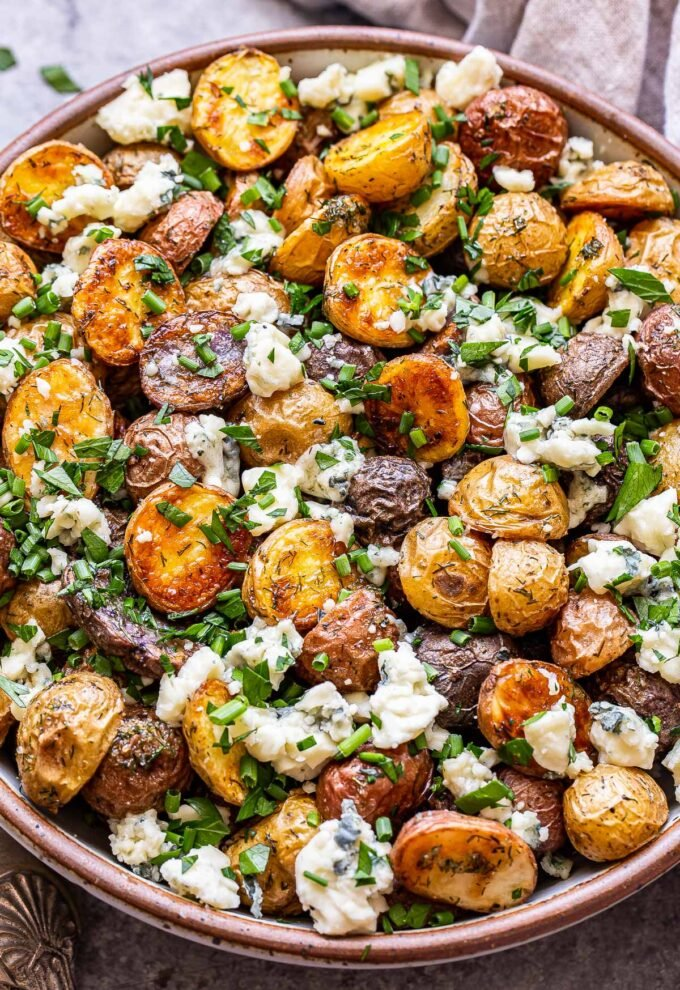 herb roasted potatoes with blue cheese in a serving bowl.