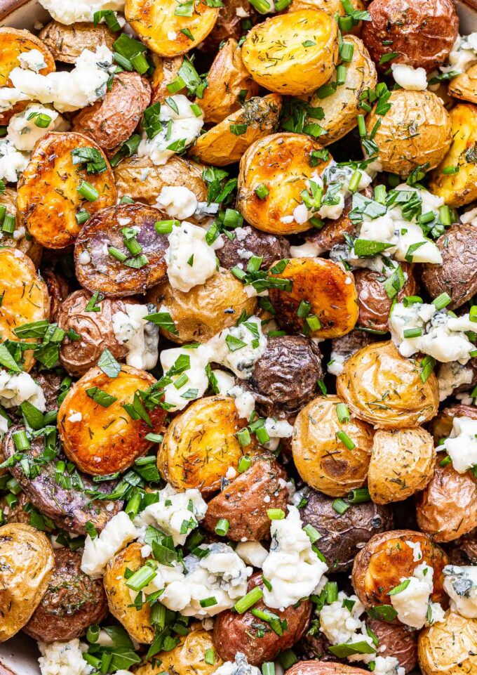 closeup photo of herb roasted potatoes with blue cheese