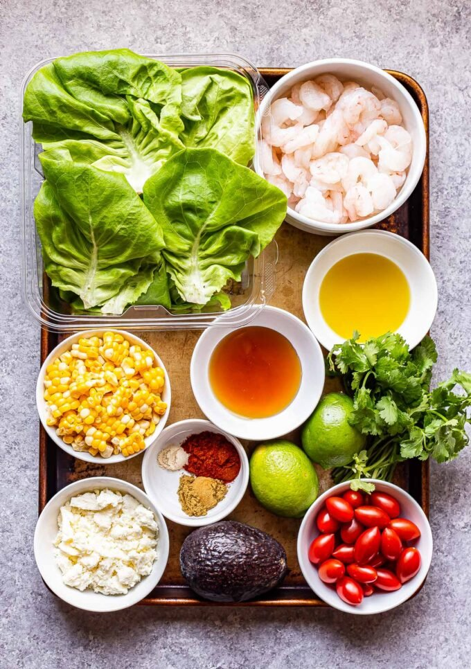 ingredients used to make Honey Lime Shrimp Salad on a sheet pan.