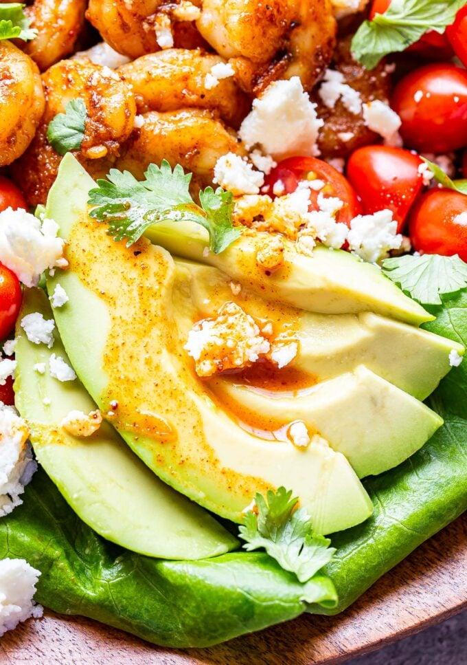 Avocado slices on the Honey Lime Shrimp Salad.