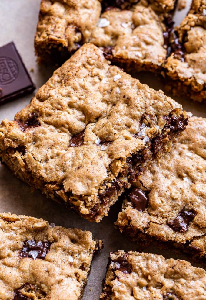 One Oatmeal Chocolate Chunk Cookie Bar propped up on another bar.
