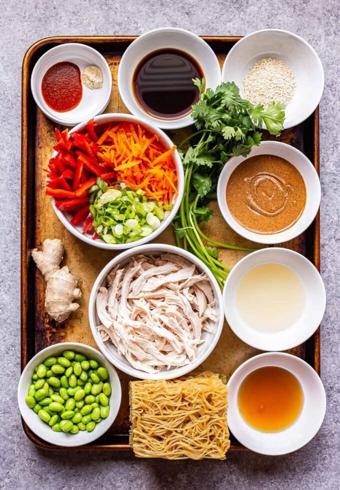 ingredients used to make Sesame Chicken Noodle Bowls on a sheet pan.