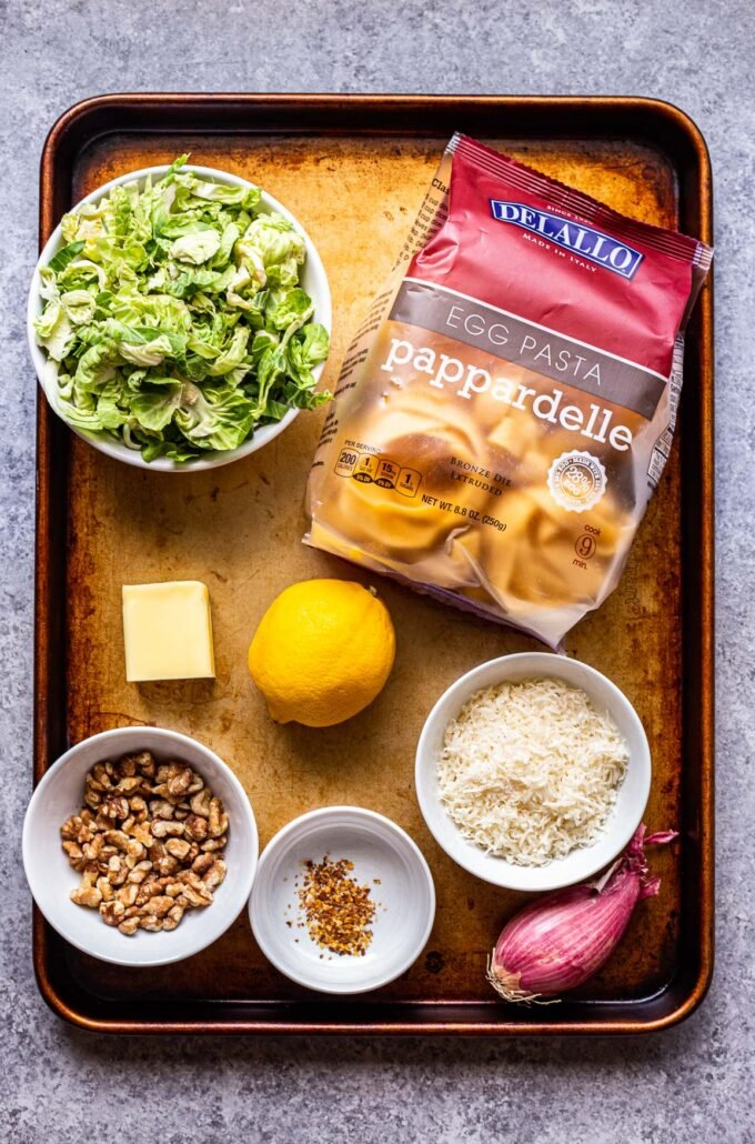 ingredients for brown butter brussels sprouts pasta on a sheet pan