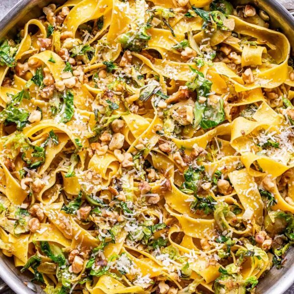 brown butter brussels sprouts pasta in a stainless steel skillet