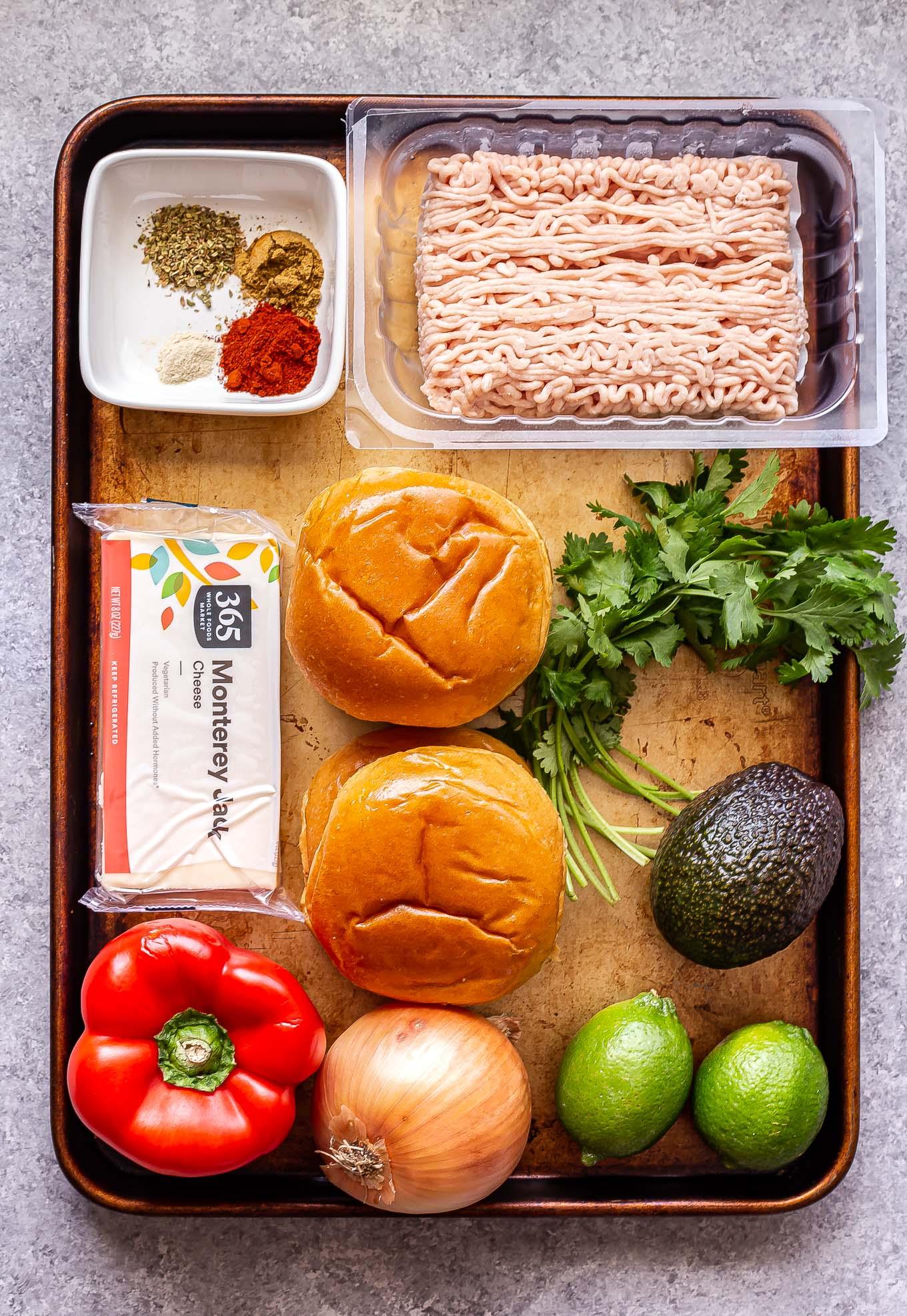 ingredients for Chicken Fajita Burgers on a sheet pan