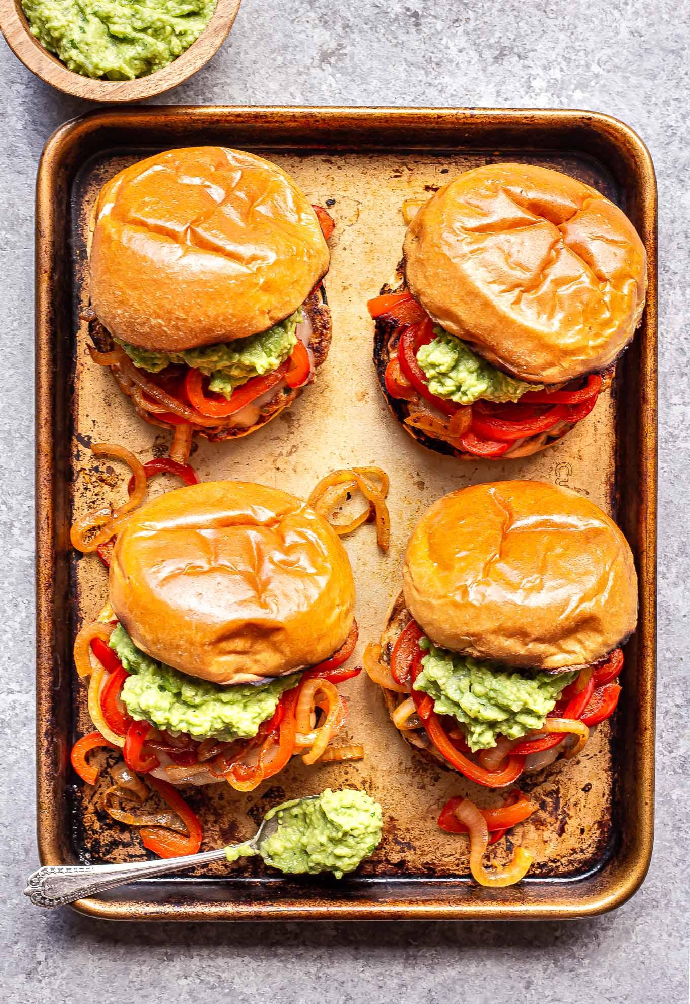 four Chicken Fajita Burgers on a sheet pan