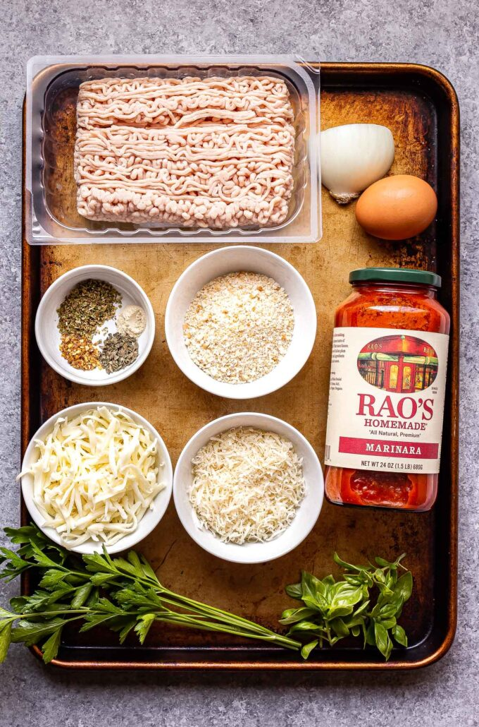 ingredients used to make Chicken Parmesan Meatballs on a sheet pan