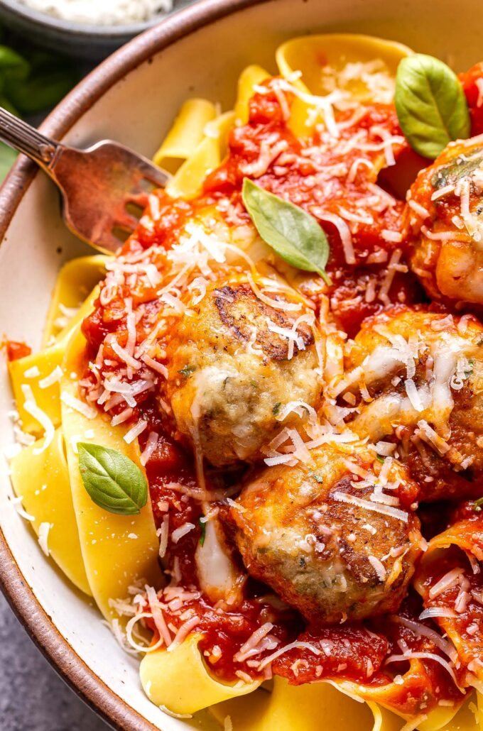Chicken Parmesan Meatballs on top of pasta