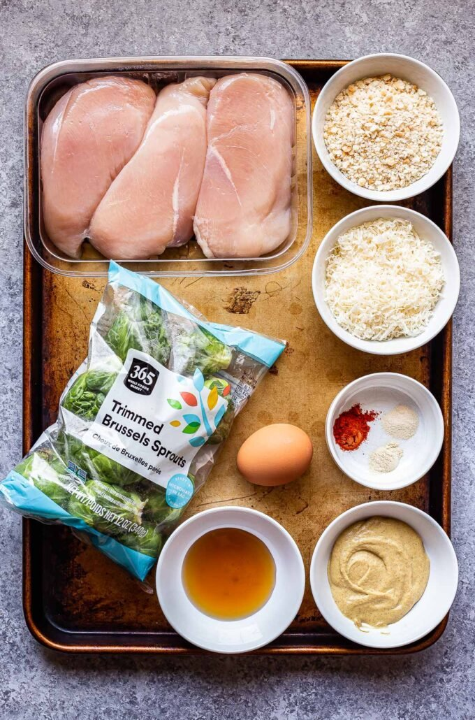 ingredients used to make Parmesan chicken and brussels sprouts on a sheet pan.